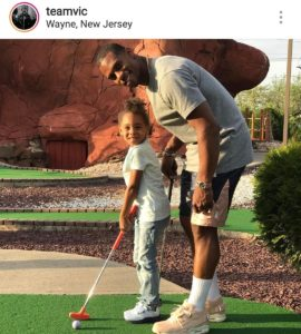 Victor Cruz leaning over during mini golf with a distinct hinge in his lower spine - a link to knee tendonitis