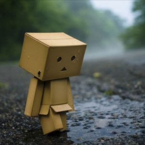 box person looking sad in rain similar to person with fibromyalgia