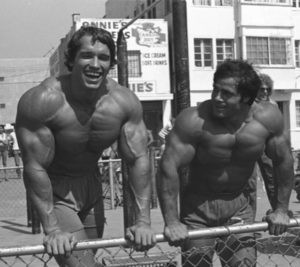 arnold shwarzenegger and franco columbo shirtless post resistance training and smiling symbolizing it as a viable treatment for depression